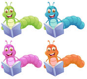 Four worms reading Royalty Free Stock Image