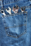 Four Wrenches in Blue Jean Pocket Stock Image