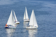 Four yachts making a close turn near buoy Royalty Free Stock Photo