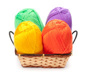 Four yarn skeins in yellow, orange, green, purple colors Stock Image