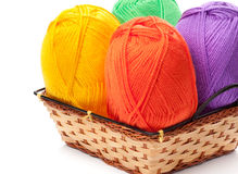 Four yarn skeins in yellow, orange, green, purple colors Stock Images