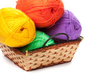 Four yarn skeins in yellow, orange, green, purple colors Royalty Free Stock Image