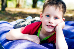 Four year boy lying on inflatable mattress Stock Image