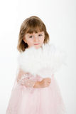 Four-year girl in a beautiful pink dress with a fan. Stock Images