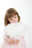 Four-year girl in a beautiful pink dress with a fan. Royalty Free Stock Photo