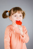 Four-year girl with the big sugar candy Royalty Free Stock Images