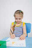 Four-year girl draws pencils Royalty Free Stock Photography