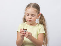 Four-year girl eats a chocolate sweet tooth. Portrait of a four-year European girls Kushan chocolate Royalty Free Stock Image