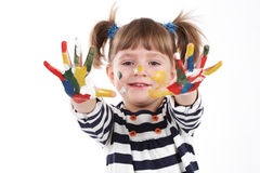 Four-year girl with hands soiled in a paint. Royalty Free Stock Image