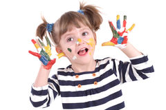 Four-year girl with hands soiled in a paint. Stock Image
