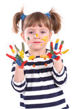 Four-year girl with hands soiled in a paint. Stock Photo