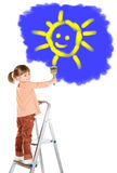 Four-year girl on a ladder and draws a picture. Stock Image