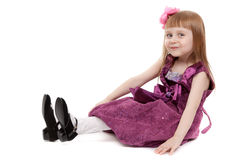 Four-year girl sitting on white floor Royalty Free Stock Photo