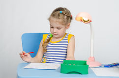 Four-year girl thought drawing pencils Stock Photography
