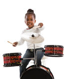 Four Year Old African American Girl Playing Drum Set Isolated Royalty Free Stock Photography