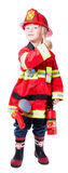 Four year old boy dressed as a fireman shows that all is well Stock Photos