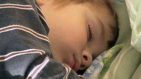 Four year old boy sleeping tight 02 stock video footage