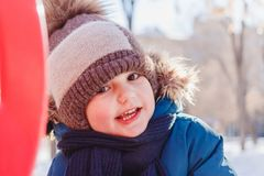Four-year-old boy on a walk in winter stock photos