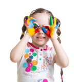 Four year old child girl with hands painted in. Color paints isolated Stock Photos