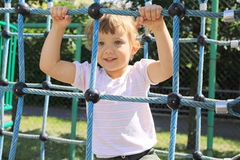 Four year old girl on the playground Stock Photos