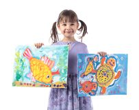 Four-year-old girl in a purple dress shows her drawings. Paintings drawn by gouache. Isolated on white background stock images