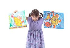 Four-year-old girl in a purple dress shows her drawings. Paintings drawn by gouache. Isolated on white background royalty free stock photo