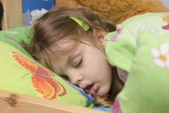 Four-year-old girl sleeping in the crib Stock Photography