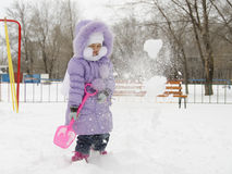 Four-year-old girl threw herself with snow shovels Stock Photo
