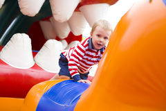 Four-year-old kid playing on a trampoline Stock Photography