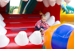 Four-year-old kid playing on a trampoline Stock Images