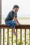 Four Year Old on Porch-rail Stock Photo