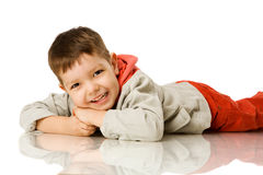Four years boy. Lying on floor isolated Royalty Free Stock Images