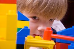 Four years boy playing. With colorful blocks Royalty Free Stock Image