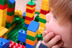 Four years boy playing. With colorful blocks stock image