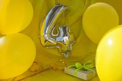Celebration yellow background, a gift box with ribbon, magic ball and wand. Copy space. royalty free stock images