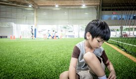 Four years old boy is practicing on soccer training field with copy space royalty free stock image