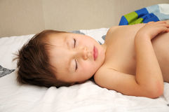 Four years old boy sleeping. Four years old caucasian cute  pretty boy sleeping Royalty Free Stock Photo