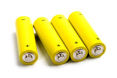 Four yellow alkaline batteries Royalty Free Stock Photography