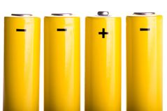 Four yellow batteries standing Stock Photo