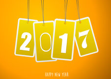 Four yellow hanging labels with 2017 year. Vector art Stock Images