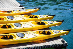 Four Yellow Kayaks Stock Photos