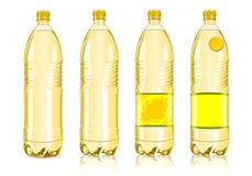 Four yellow plastic bottles with labels Royalty Free Stock Photos