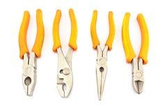 Four yellow pliers Royalty Free Stock Photos