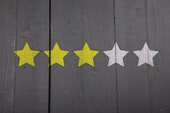 Four yellow ranking stars Royalty Free Stock Photos
