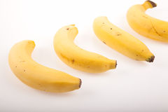 Four  yellow ripe bananas Royalty Free Stock Images