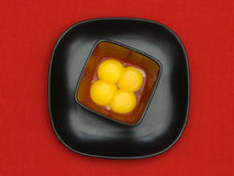 Four yolks in a bowl Stock Image