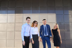 Four young adult elegant people, two women and two men students Stock Photo