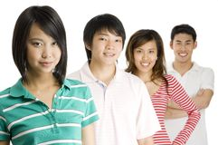 Four Young Adults. Four young asian men and women standing in a row (Shallow depth of field used stock photos