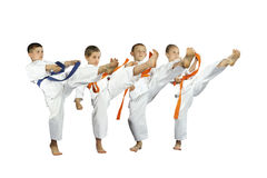 Four young athletes are beating the blow mae geri Stock Image
