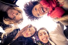 Four young beautiful girls smiling Royalty Free Stock Photography
